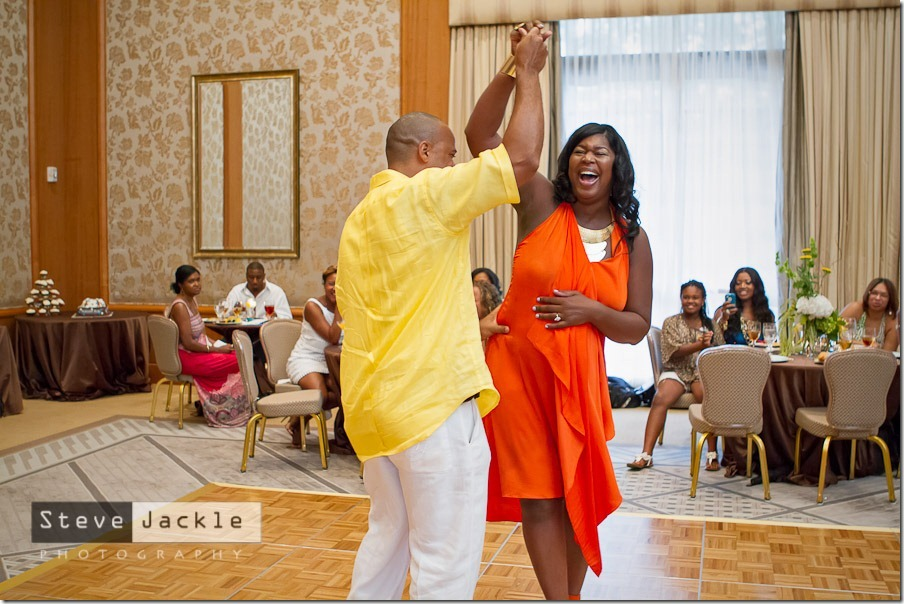 Husband and Wife dancing to celebrate the future addition to the  family